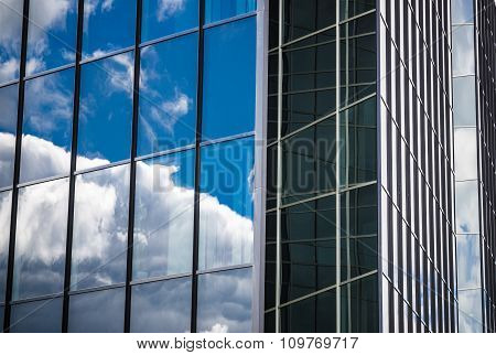 Glass Facade Of An Office Building With Reflection Of The Sky, C