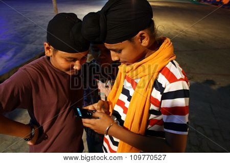 Kids on mobile phone