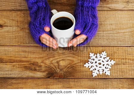Woman Hands In Teal Gloves Are Holding A Mug With Hot Coffee Or Cocoa.