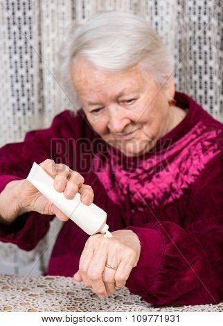 Old Woman Applying Hand Cream