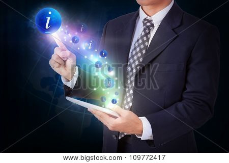 Businessman holding tablet with pressing info icon button. internet and technology concept