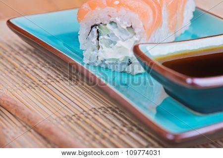 California maki sushi with fish on azul plate