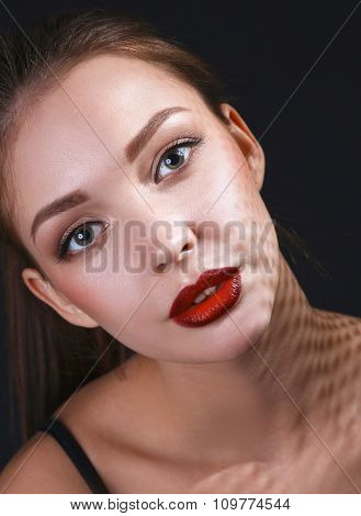 Close up portrait of beautiful young woman face