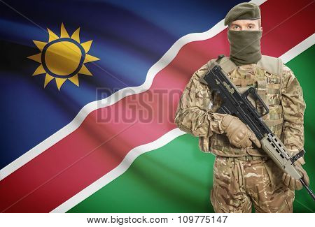 Soldier Holding Machine Gun With Flag On Background Series - Namibia