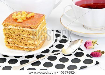 Cake with Condensed Milk, Nuts and Honey. Tea, Tableware.