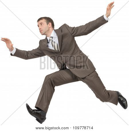 Businessman in suit running fast on white