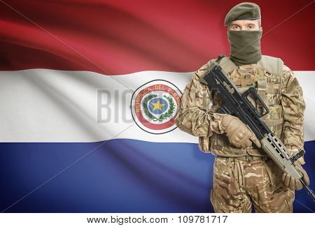 Soldier Holding Machine Gun With Flag On Background Series - Paraguay