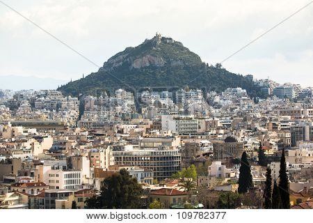 ATHENS, GREECE - CIRCA APR, 2015: Panorama of the Lycabettus Hill and streets labyrinth of Greek capital Athens.