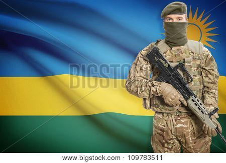 Soldier Holding Machine Gun With Flag On Background Series - Rwanda