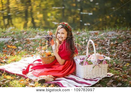Smiling Little Girl With Baskets