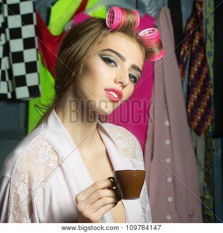 Woman With Hair-curlers And Coffee