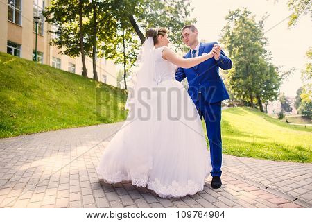 Bride And Groom Is Dancing Together