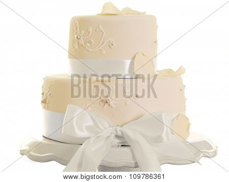 Beautiful layered cake for wedding or other celebration in restaurant, isolated on white