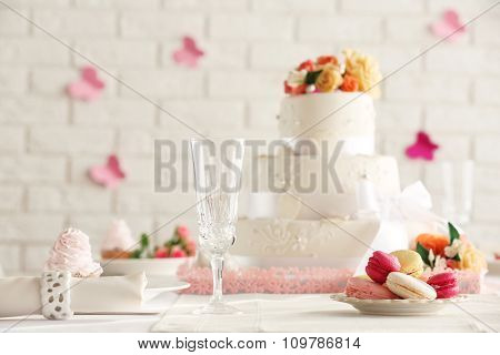 Beautiful decorated table for wedding on white wall background