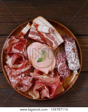 Assorted deli meats - ham, sausage, salami, parma, prosciutto, bacon