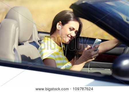 Young woman in the car outside