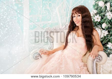 The Girl In A Beautiful Wedding Dress, Sitting In A Luxury Chair In The New Year And Christmas Decor