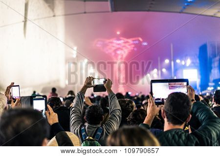 Crowd Filming At An Event