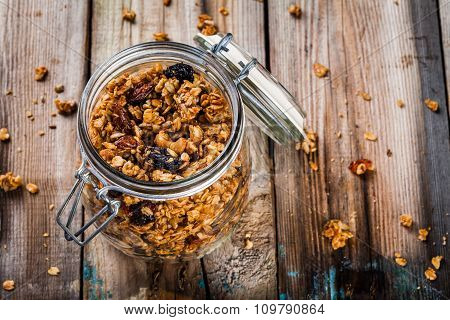 Homemade Granola With Raisins And Nuts In A Glass Jar