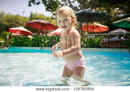 Closeup Small Blonde Girl Smiles Plays In Shallow Swimming Pool