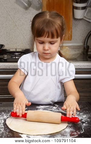 Little Girl With A Dough And Rolling-pin