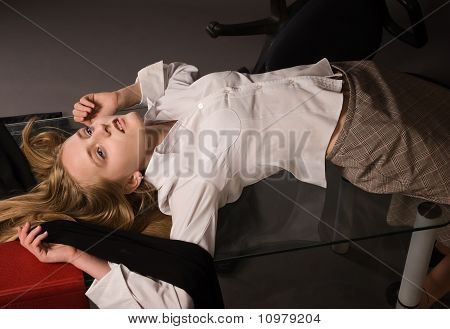 Lifeless Girl Lying On A Table