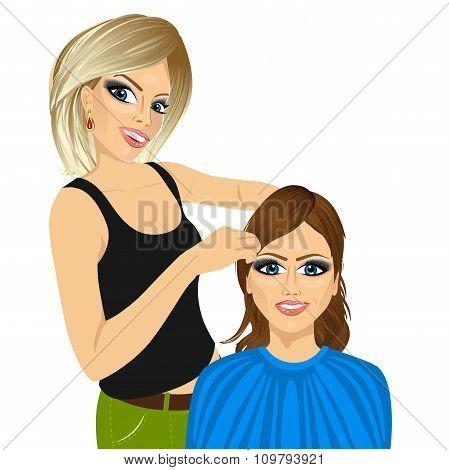 hairdresser working cutting long hair