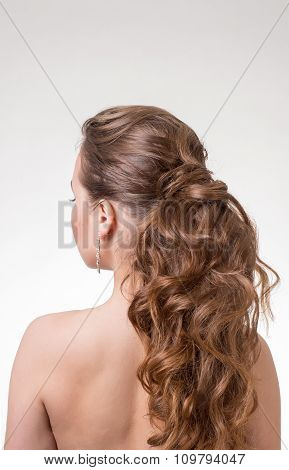 Beautiful long wavy hair. Back view