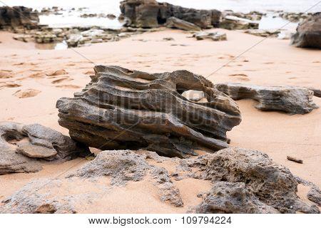 Stones on a sandy beach in the Caribbean