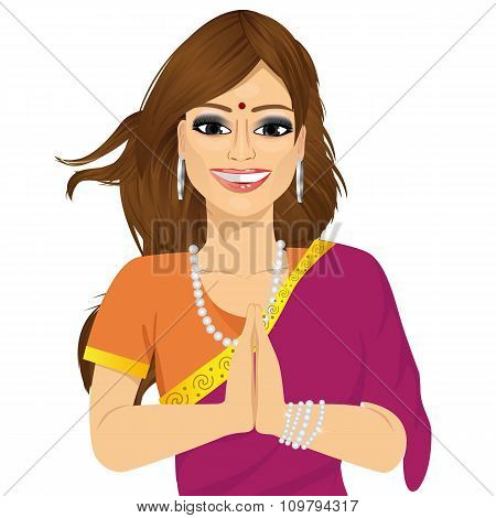 Traditional Indian woman holding hands in prayer position