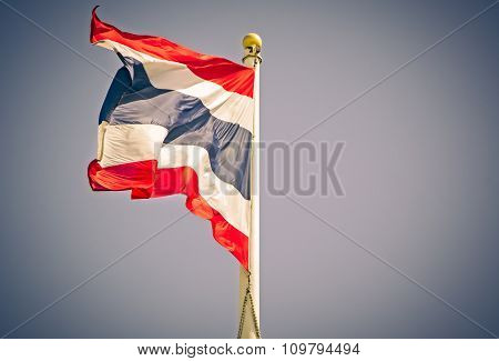 Thailand flag blows in the wind against a blue sky