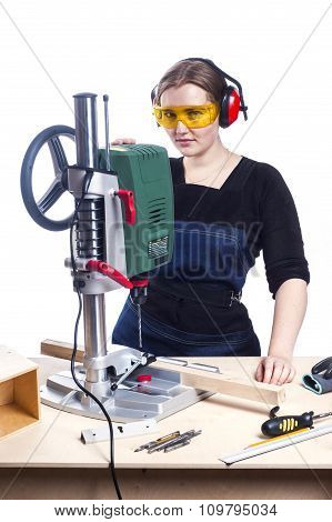 Female Carpenter And Drilling Machine.