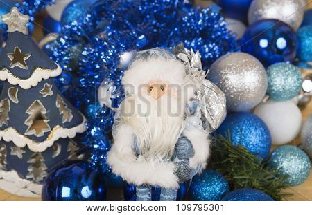 Santa Claus And Christmas Candlestick On Blue Background.