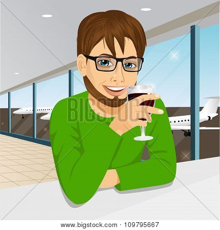 handsome man with glasses drinking wine