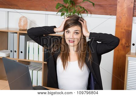Bored Brunette Business Woman Typing On Her Laptop In An Office