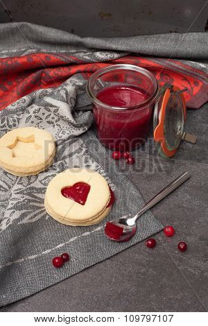 Lemon and ginger biscuits with cranberry jam.