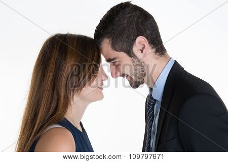 The Man Embraces The Girl On A White Background Isolated