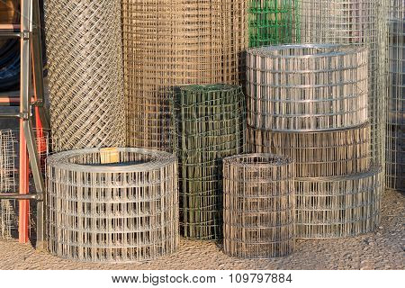 Rolls of metal wire fence different heights