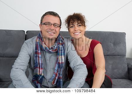 Enjoying Every Minute Together. Beautiful Loving Couple Sitting Together On The Couch