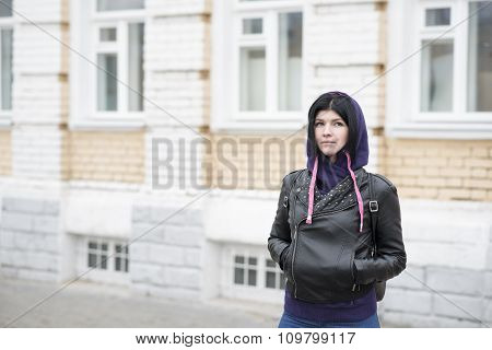 Outdoors fashion brunette standing in the street