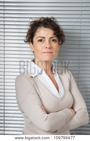 Female Professional Portrait. Caucasian Businesswoman Smiling. Executive In Her Forties