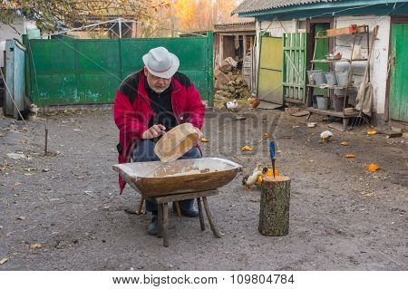 Ukrainian peasant doing daily work