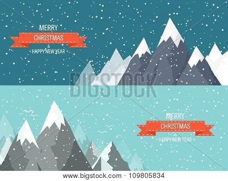 two Christmas cards with mountains