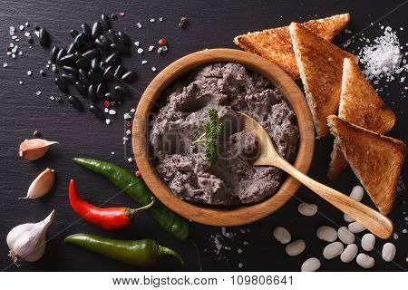 Mexican Cuisine: Pate Of Black Beans Close-up. Horizontal Top View
