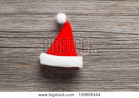 Single Santa Claus Red Hat On Wooden Background