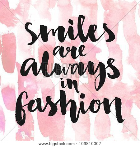 Smiles are always in fashion. Inspirational quote handwritten with black ink and brush, custom lette