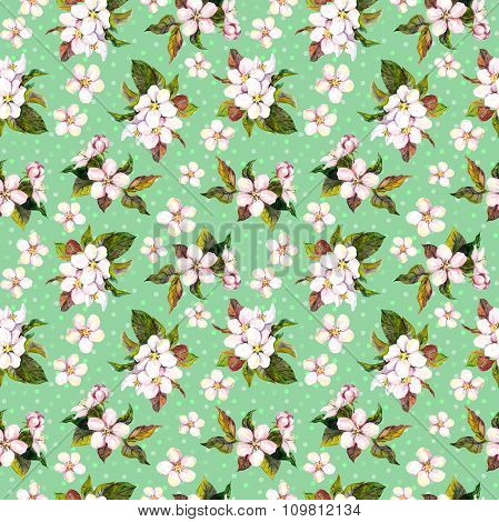 Seamless floral pattern with watercolor painted apple tree flowers on polka dots green background