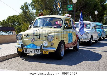 Mallorca, Spain - May 30: The Seat 600 Classic Car Parade And Tourists On May 30, 2015 In Mallorca,