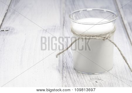 Glass Of Milk On White Wooden Table