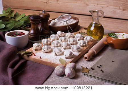 dumplings rural village board bay leaf still-life plank wood flour ingredients appetizing nourishing